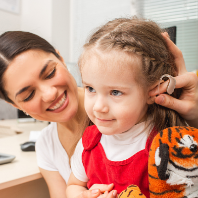 dr and child with hearing aids 2