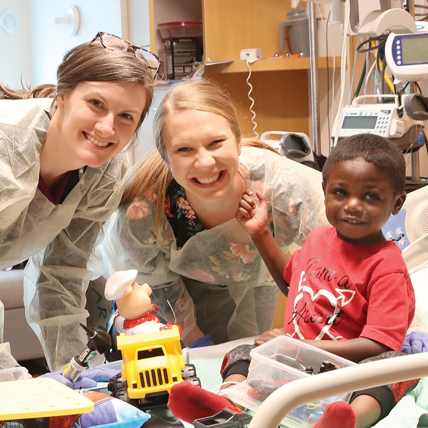 Carter Williams, 3 years old withAudiologists KathleenColella (left) and Susan Reynolds (center);